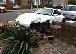 car crashed into wall of house