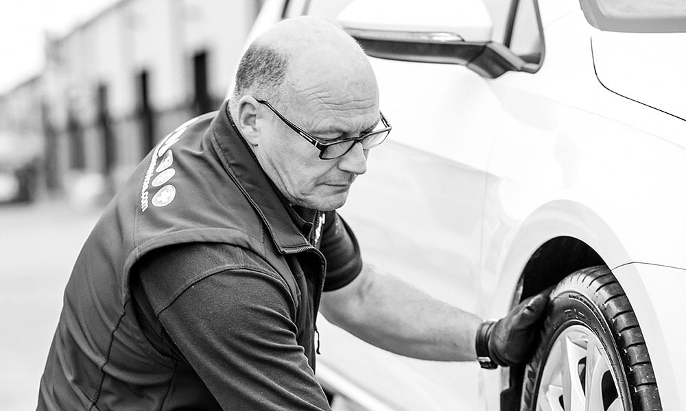 Darryl Burrows repairing a car